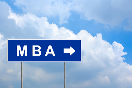 mba: MBA or Master of Business Administration on blue road sign with blue sky
