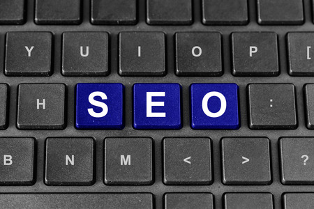 meta tags: blue SEO or search engine optimization word on keyboard