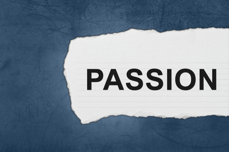 Passion with white paper tears on blue texture photo