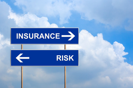 financial insurance: Insurance and risk on blue road sign with blue sky Stock Photo