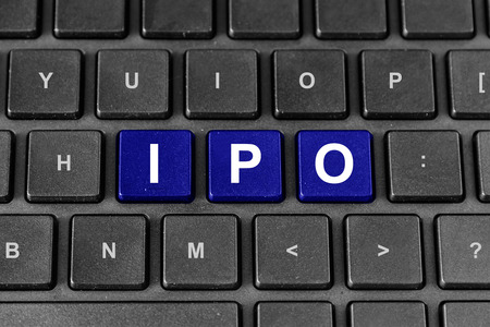 public offering: blue IPO or initial public offering word on keyboard
