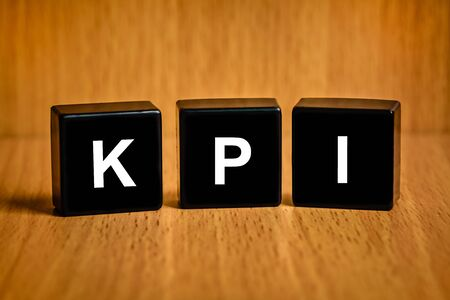 KPI or Key Performance indicator text on black block , business concept photo