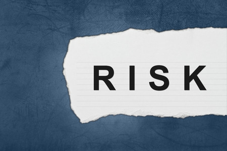 Risk with white paper tears on blue texture photo