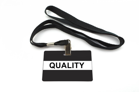 quality badge with strip isolated on white background photo