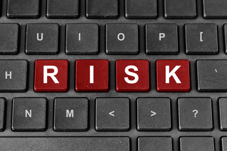 Risk red word on keyboard, business financial concept photo