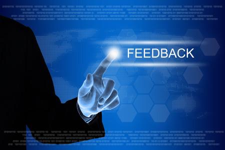 business hand pushing feedback button on a touch screen interface  Standard-Bild