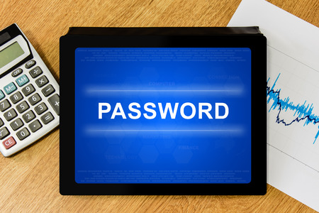 logon: password on digital tablet with calculator and financial graph Stock Photo