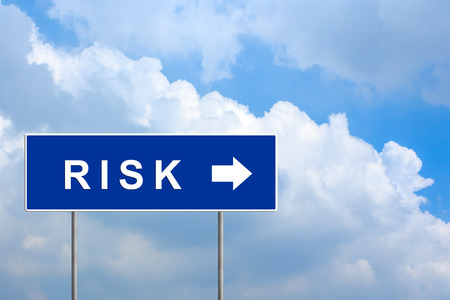 financial risk on blue road sign with blue sky photo