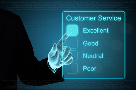 excellent service: business hand pushing customer service on a touch screen interface