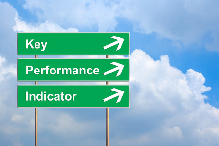 KPI or Key Performance indicator on green road sign with blue sky Stock Photo