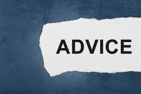 advice with white paper tears on blue texture photo