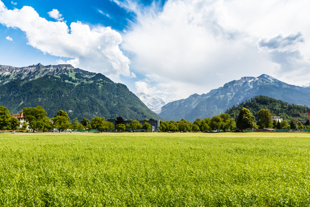 Scenic mountain landscape with blue sky in Interlaken, Switzerland photo