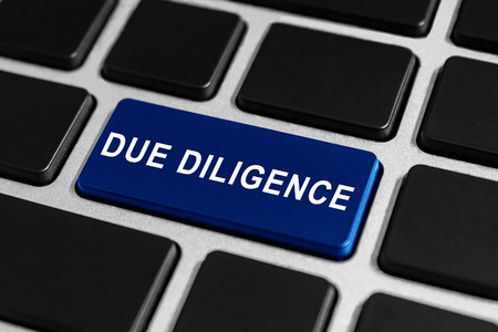 mergers: due diligence blue button on keyboard, business concept