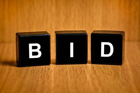 winning bidder: bid text on black block, business concept