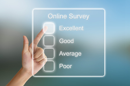 online survey: hand clicking online survey on virtual screen interface