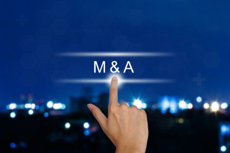 merge: hand clicking M&A or Merger and Acquisition button on a touch screen interface  Stock Photo