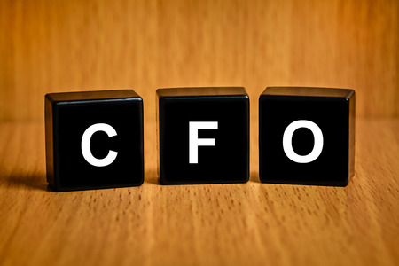 loss leader: CFO or Chief financial officer text on black block