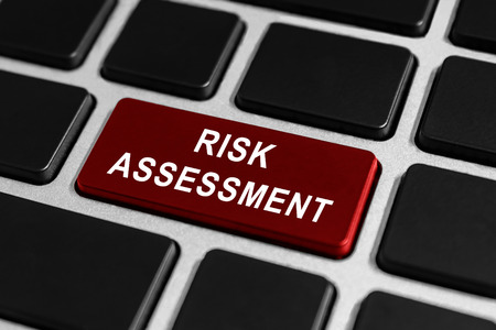 risk assessment red button on keyboard, business concept photo