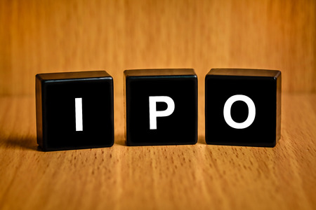 public offering: IPO or Initial public offering text on black block Stock Photo