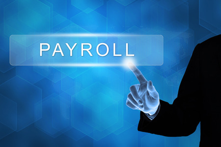 payroll: business hand touching payroll button on a touch screen interface