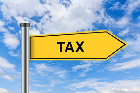 accounting tax words on yellow road sign on blue sky photo