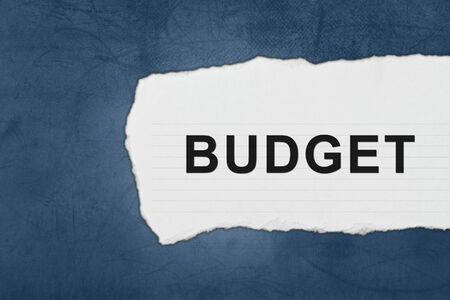 deficit target: budget with white paper tears on blue texture