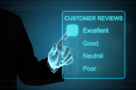 testimonial: business hand pushing customer review feedback on a touch screen interface Stock Photo