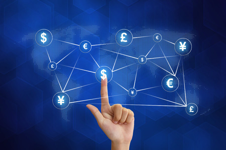 hand pushing global currency networking with blue background Standard-Bild