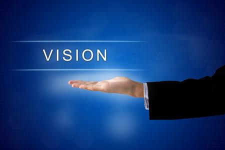 bouton de vision avec la main d'affaires sur une interface à écran tactile Banque d'images
