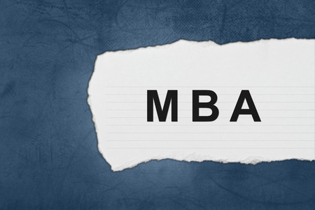 MBA or Master of Business Administration with white paper tears on blue texture photo