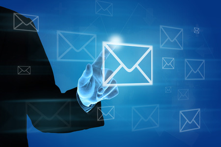 hand pushing e-mail icon on screen, business concept photo