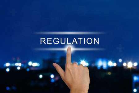 hand clicking regulation button on a touch screen interface Standard-Bild