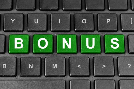 additional compensation: bonus green word on keyboard, business concept