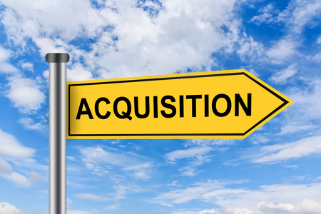 company ownership: merger and acquisition words on yellow road sign on blue sky