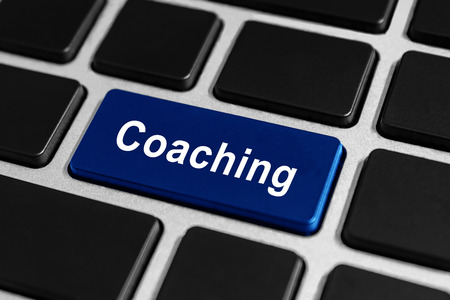 coaching blue button on keyboard, business concept photo