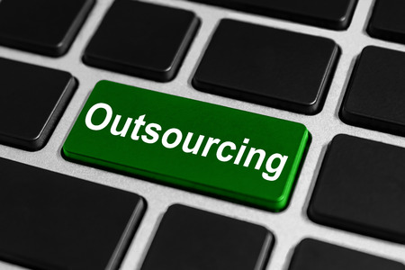 Outsourcing green button on keyboard, business concept photo