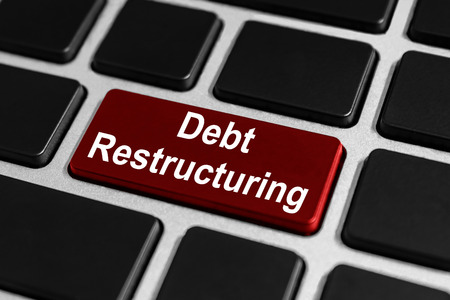 restructuring: debt restructuring red button on keyboard, business concept