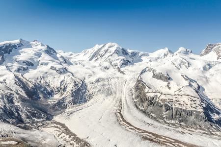 Snow Mountain Range Landscape with Blue Sky, Alps, Switzerland photo
