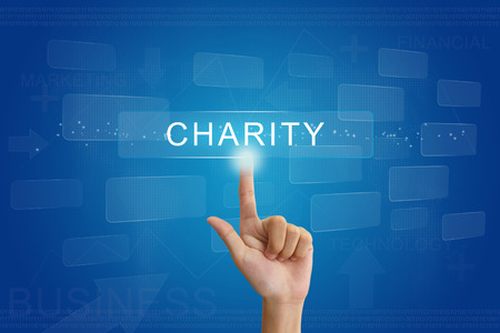 hand press: hand press on charity button on virtual screen Stock Photo