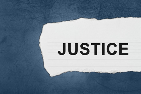 legality: justice with white paper tears on blue texture Stock Photo