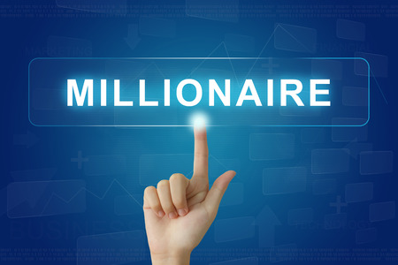 hand press on millionaire button on virtual screen 스톡 콘텐츠