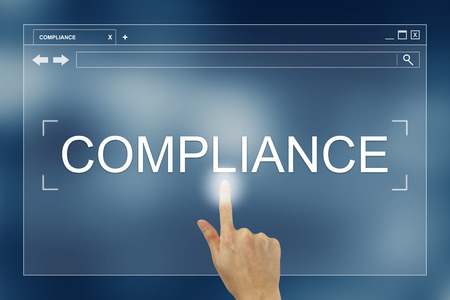 compliant: hand press on compliance button on webpage Stock Photo
