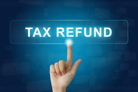 tax return: hand press on tax refund button on virtual screen