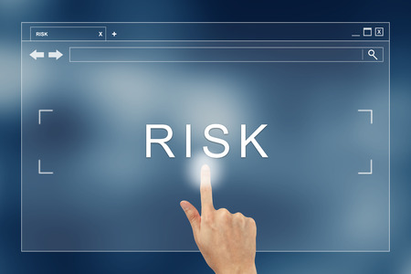 hand press on risk button on webpage photo