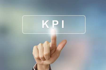 performance improvement: hand pushing KPI or Key Performance Indicator button