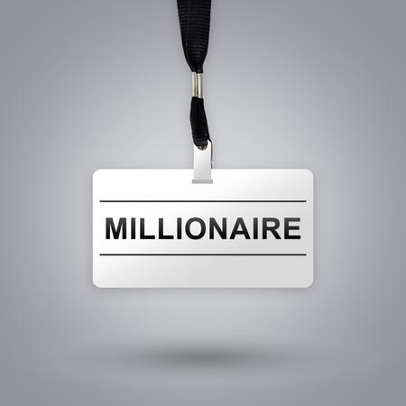 hombre millonario: millonario en placa con fondo gris degradado radial Foto de archivo