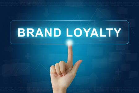 hand press on brand loyalty button on virtual screen Stock Photo