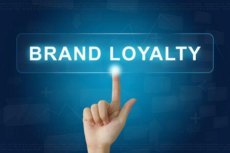 hand press: hand press on brand loyalty button on virtual screen Stock Photo
