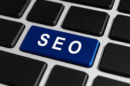 meta analysis: SEO or Search engine optimization button on keyboard