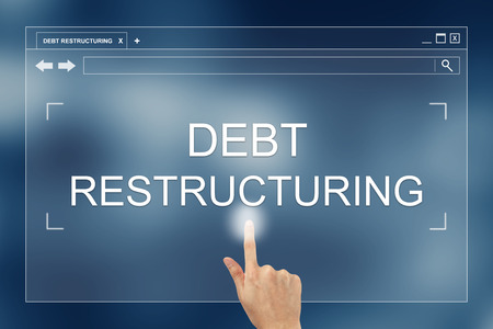 restructuring: hand press on debt restructuring button on webpage